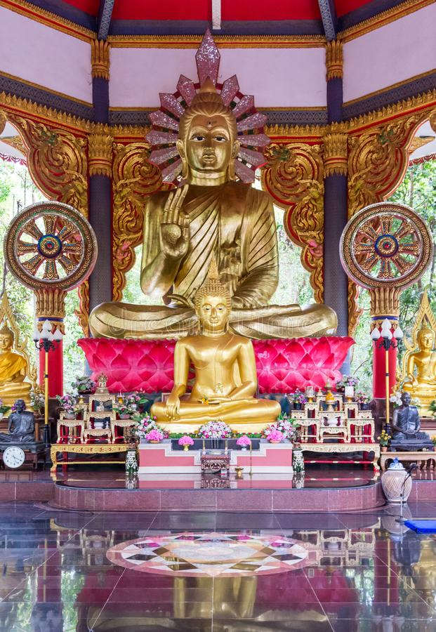Large golden Buddha statue with the small Buddha statue are all around royalty free stock images