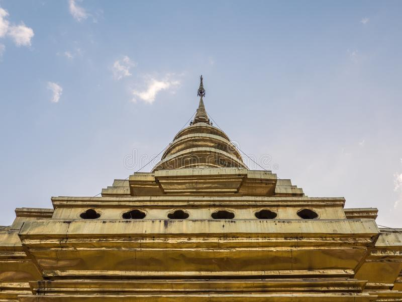 Large golden pagoda in the traditional northern thai style. royalty free stock photo