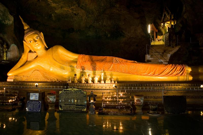 A large golden recumbent Buddha in the temple. Thailand stock photography