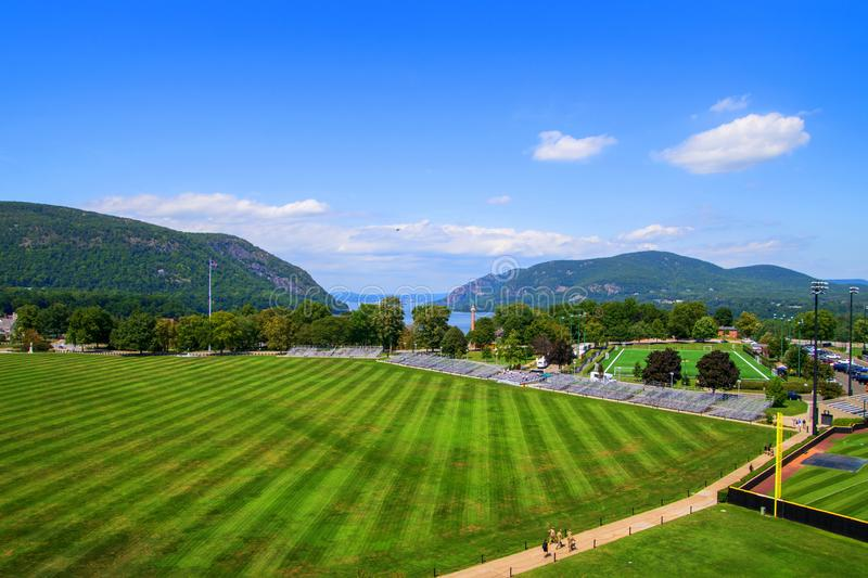 Large grassy parade field overlooking the Hudson River valley with mountains in the background stock photo