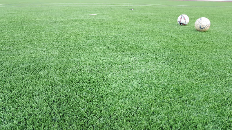 Large Green Artificial turf football with balls. Large Green Artificial turf football field with balls stock photography
