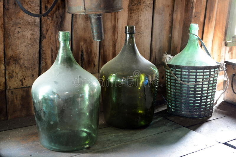 Large green glass bottles. stock photo