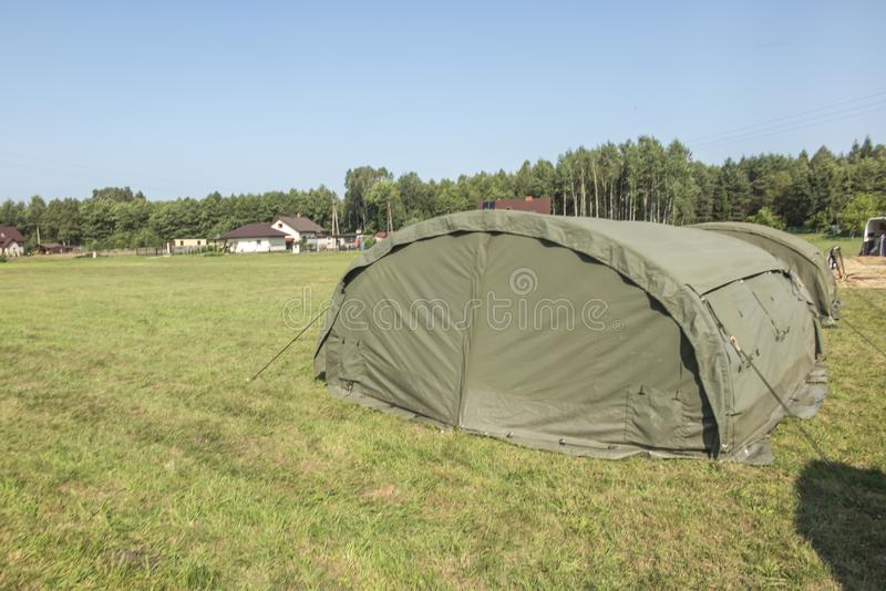 Large, green, military canvas tents stock image