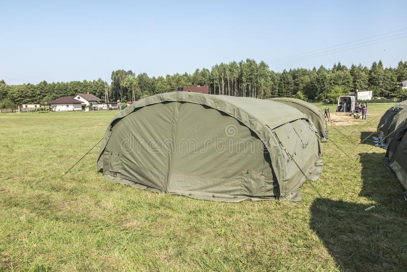 Large, green, military canvas tents royalty free stock photography