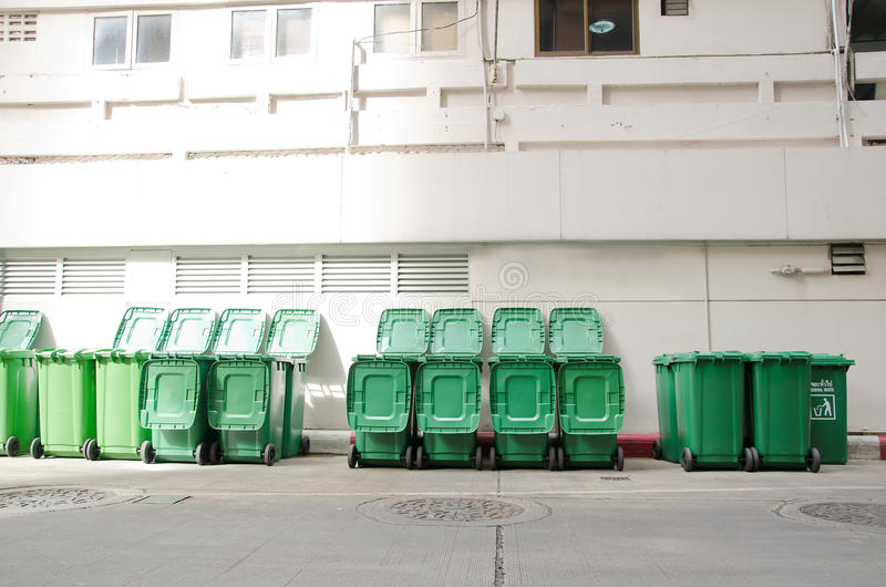 Large green trash cans. (garbage bin) with wheels royalty free stock image