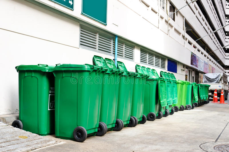 Large green trash cans. (garbage bin) with wheels stock photo