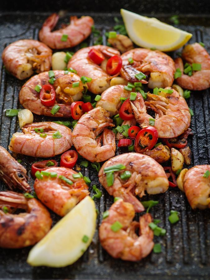 Large grilled BBQ shrimp with sweet chili sauce, green onion and. Lemon royalty free stock photo