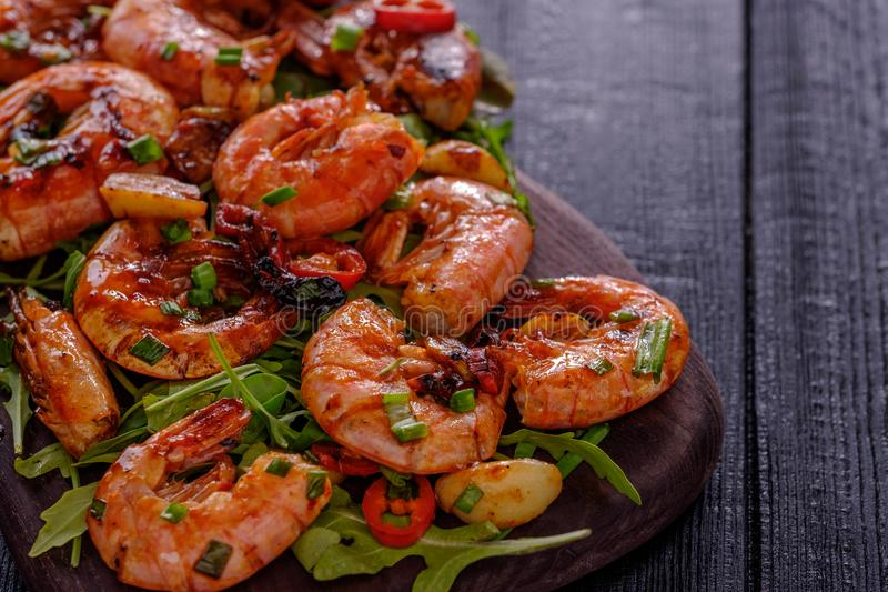 Large grilled BBQ shrimp with sweet chili sauce, green onion and. Lemon. Copyspace royalty free stock photography