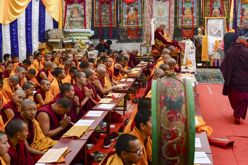 A large group of Buddhist monks hold a joint prayer in Kathmandu, Nepal royalty free stock photos