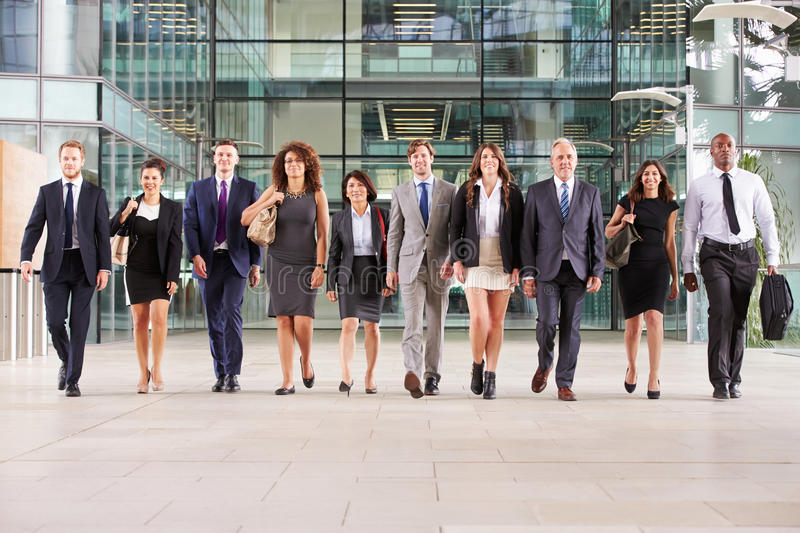 Large group of business people in lobby of a big business royalty free stock image