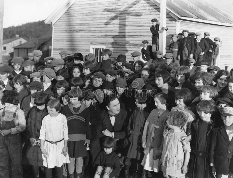 Large group of children and adults outside. (All persons depicted are no longer living and no estate exists. Supplier grants that there will be no model release royalty free stock images