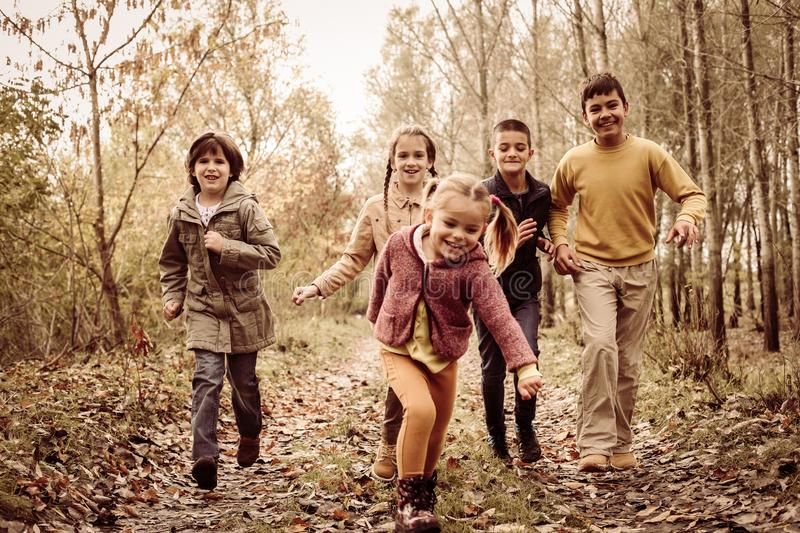 Children running together in a park. royalty free stock photos