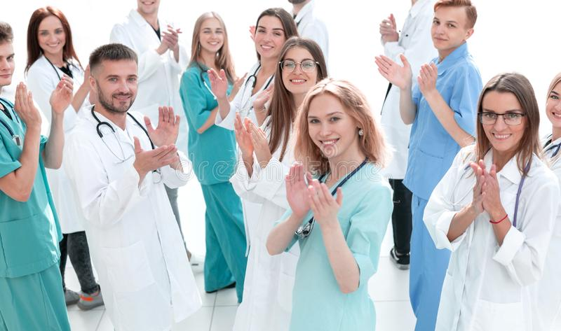 Large group of doctors congratulating each other with applause. The concept of healthcare stock photography