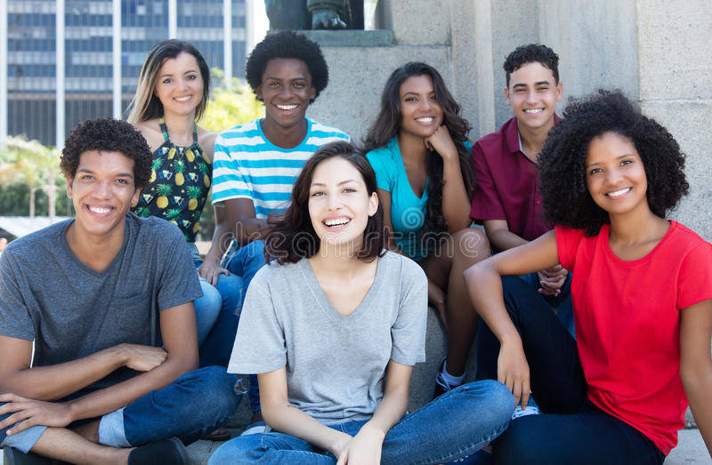 Large group of happy multiethnic young men and women stock photos