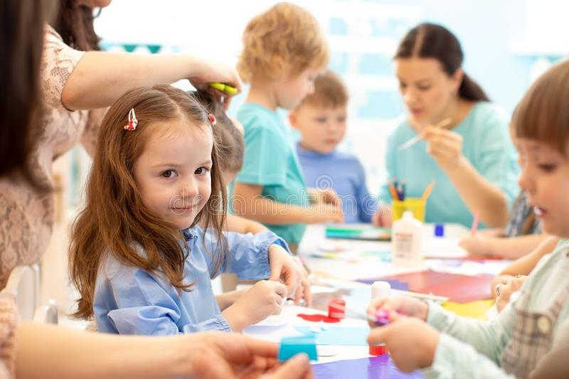 Large group of kids on the art lesson class royalty free stock images