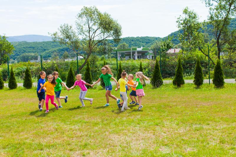 Large group of kids play outdoor games royalty free stock photos