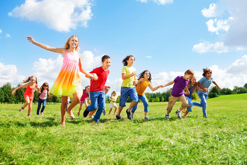 Large Group Of Kids Running In The Park Stock Images