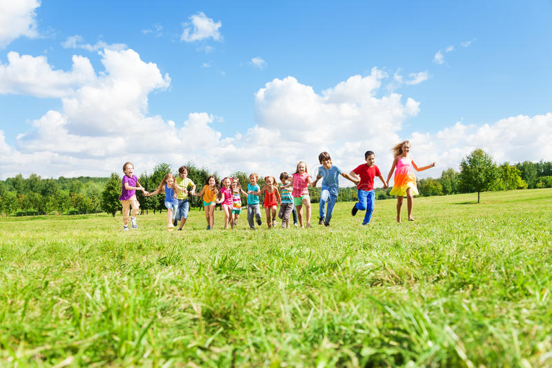 Download Large Group Of Kids Running In The Park Royalty Free Stock Photography - Image: 34659287