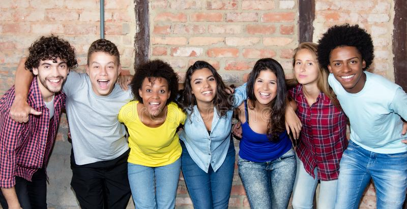 Large group of latin and african american young adult people. Looking at camera royalty free stock images
