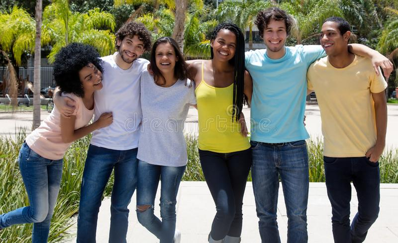 Large group of laughing international young adult people royalty free stock image