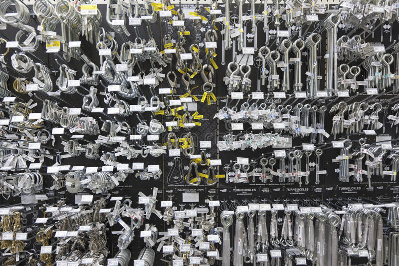 Large group of metallic equipments on display in hardware store royalty free stock photos