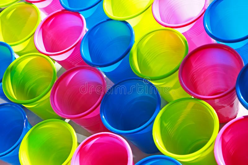 Large group of multi colored plastic cups royalty free stock photos
