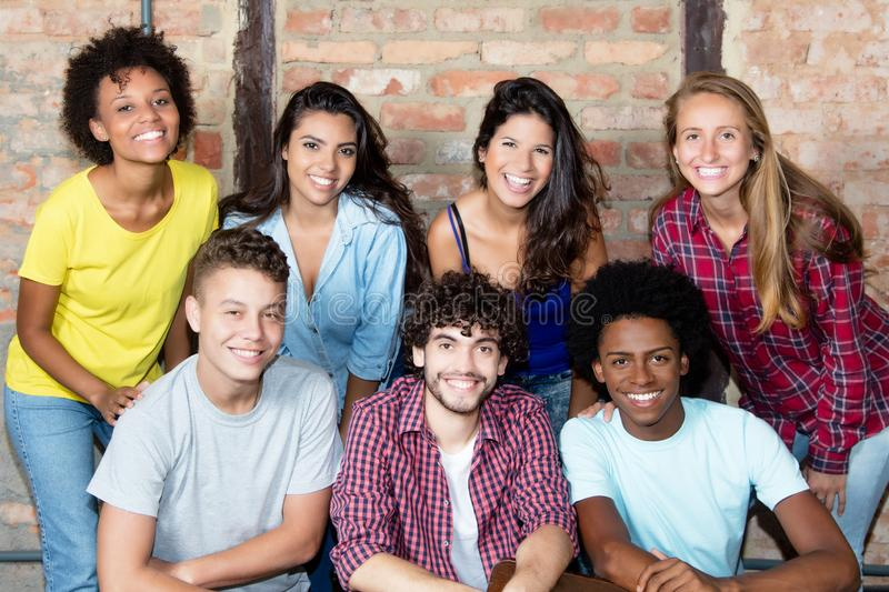 Large group of multi ethnic young adult people. Looking at camera royalty free stock photography