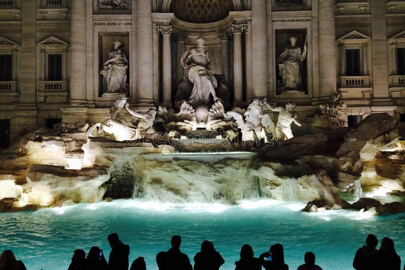 Large group of people in front of the Fontana di Trevi in the night on Roma, Italy. 2015.12.02. stock photography
