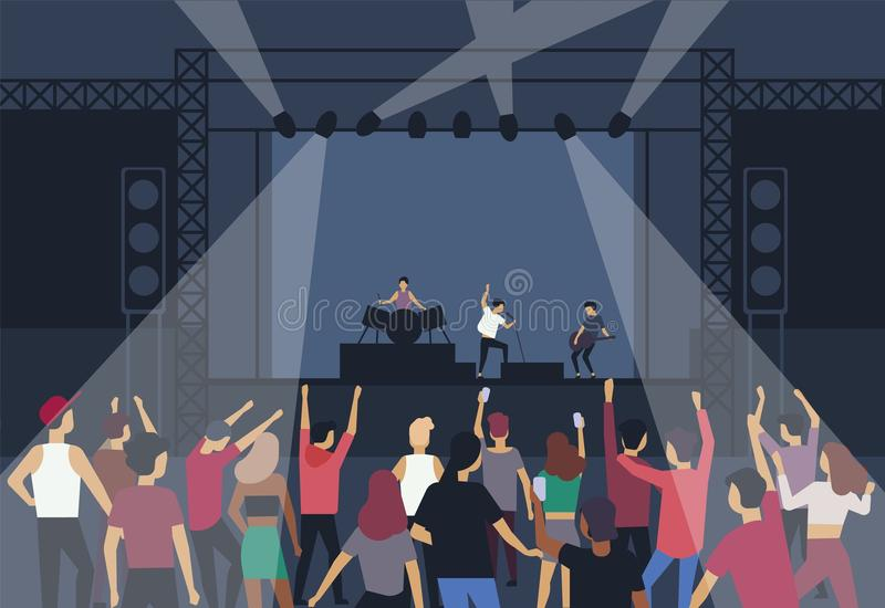 Large group of people or music fans dancing in front of stage with performing musical band, back view. Musicians stock illustration