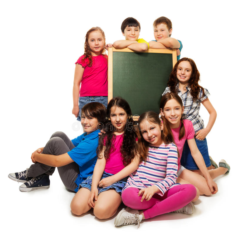 Large group of school kids and blackboard stock image