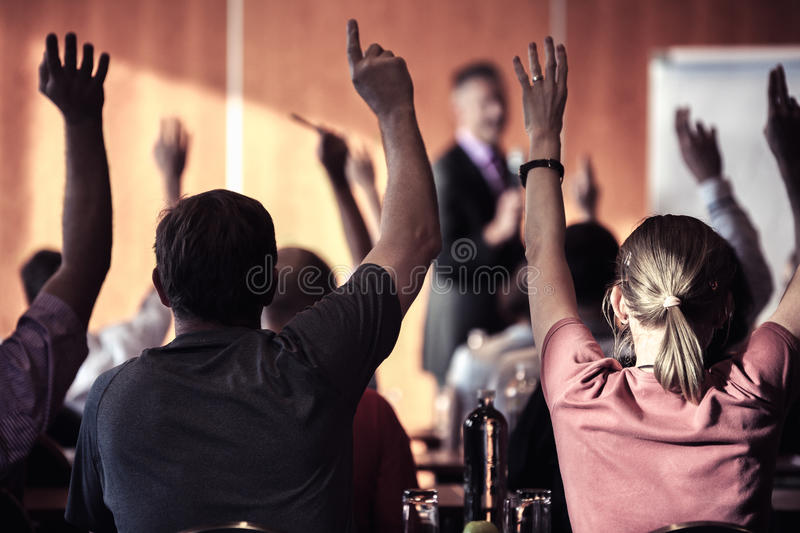 Large group of seminar audience in class room royalty free stock image