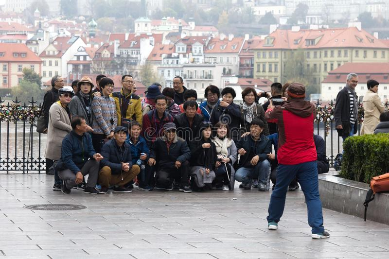 large group of tourists from South-East Asia are photographed stock image