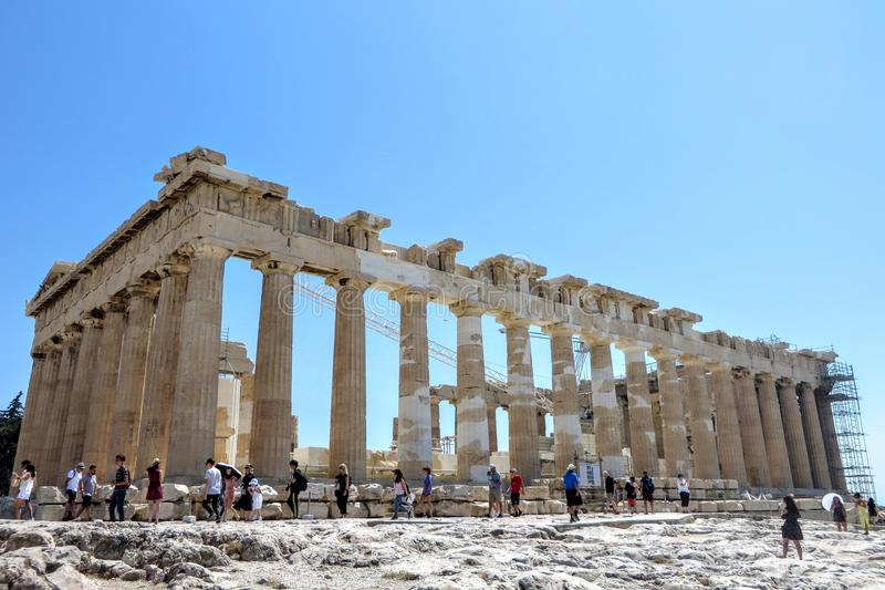 A large group of visitors admiring the Parthenon atop the Acropolis on a hot sunny day during a summer day in Athens royalty free stock photography