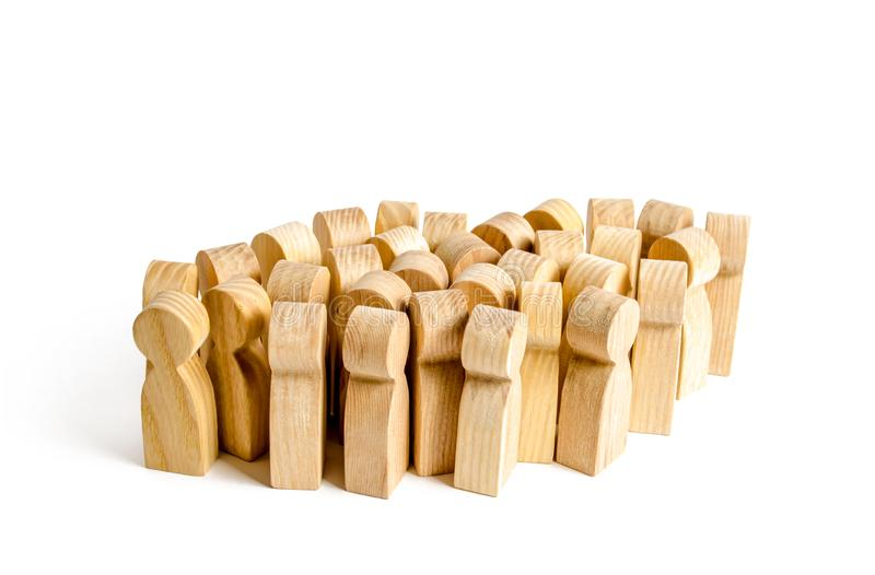 A large group of wooden figures of people. Society, community. social activity. Society, social group. Herd instinct, management royalty free stock photo