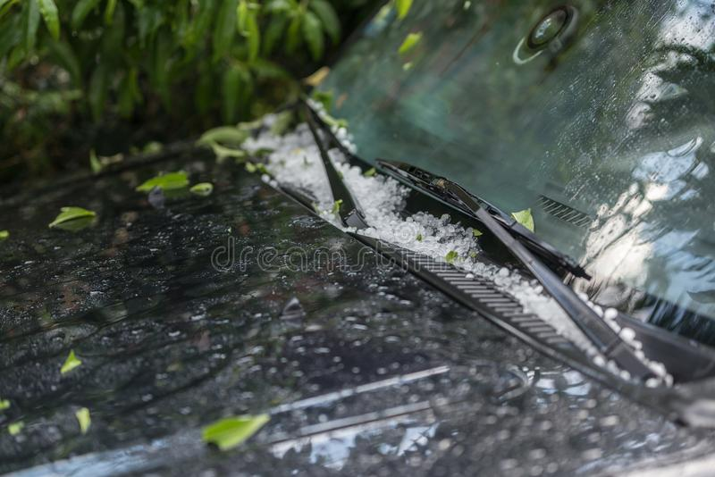 Large hail ice balls on car hood. After heavy summer storm royalty free stock image