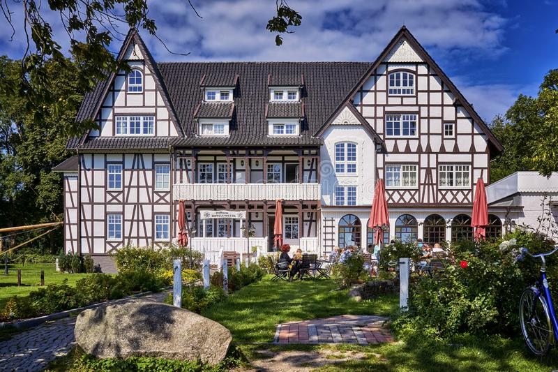 Large half-timbered house with garden in Kloster on the island of Hiddensee. Hotel, building, architecture, tourism, accommodation, amazing, vacation, ancient royalty free stock photography