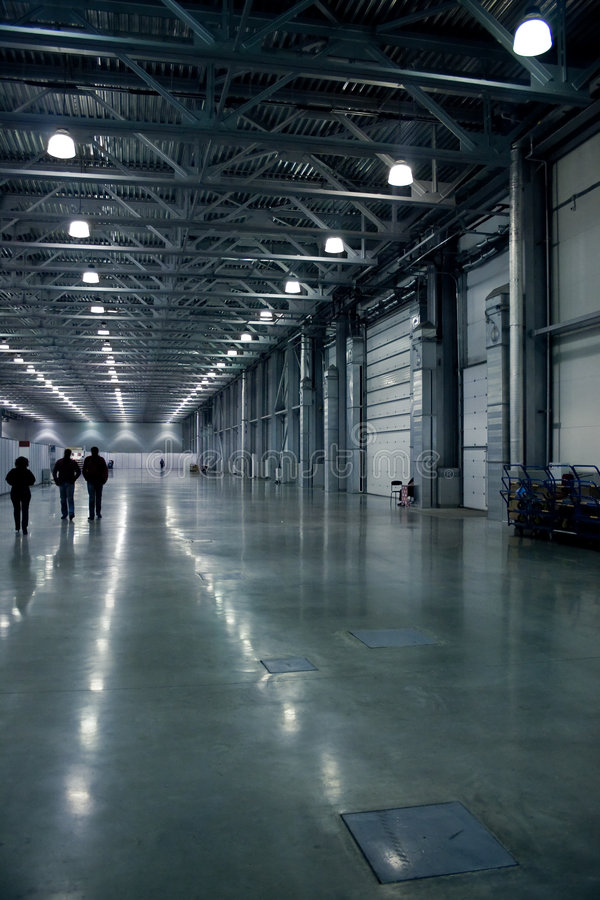 Large hall. With people silhouettes, modern architecture royalty free stock photos