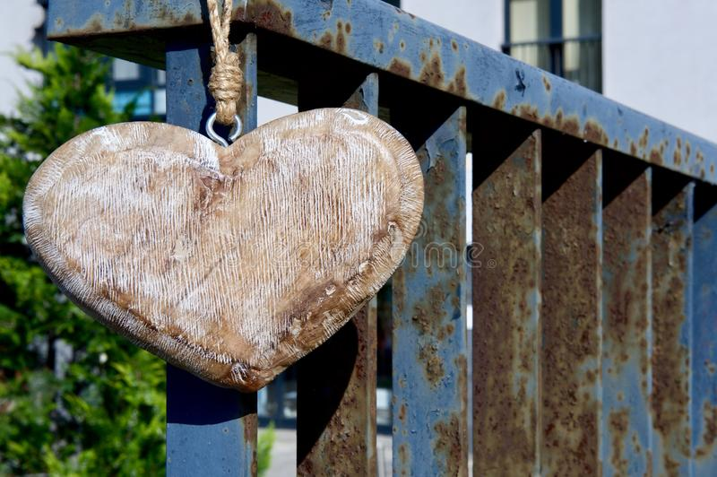 A large handmade heart made of textured wood stock photography