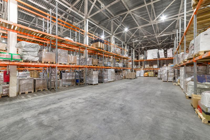 Large hangar warehouse industrial and logistics companies. Warehousing on the floor and called the high shelves royalty free stock photography