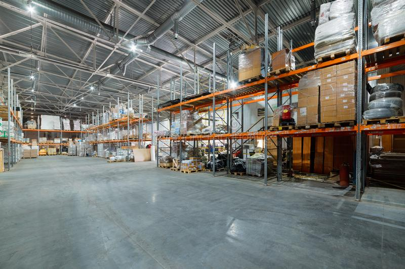 Large hangar warehouse industrial and logistics companies. Warehousing on the floor and called the high shelves royalty free stock photo