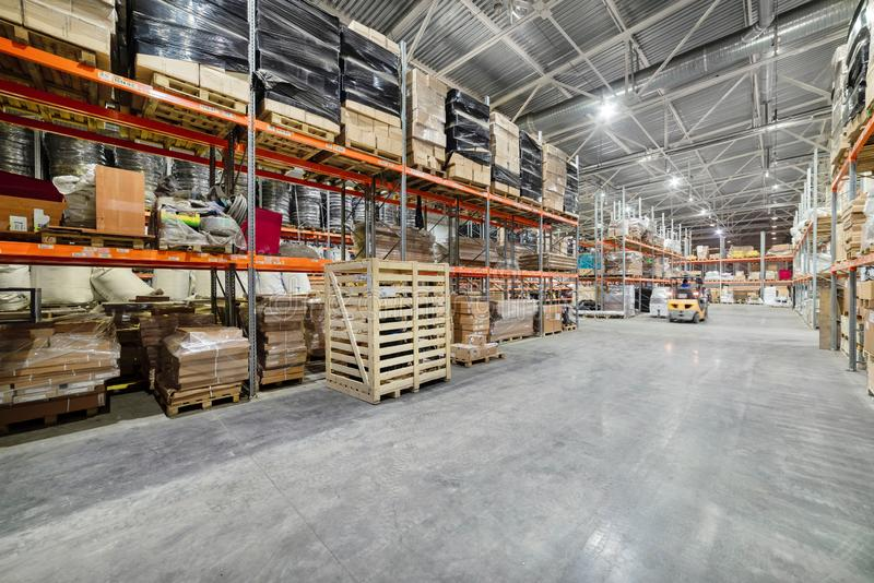Large hangar warehouse industrial and logistics companies. Warehousing on the floor and called the high shelves royalty free stock images