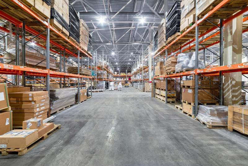 Large hangar warehouse industrial and logistics companies. Warehousing on the floor and called the high shelves stock image