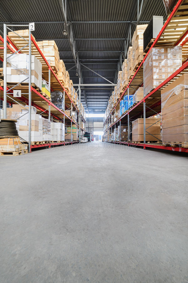 Large hangar warehouse industrial and logistics companies. Warehousing on the floor and called the high shelves stock photos