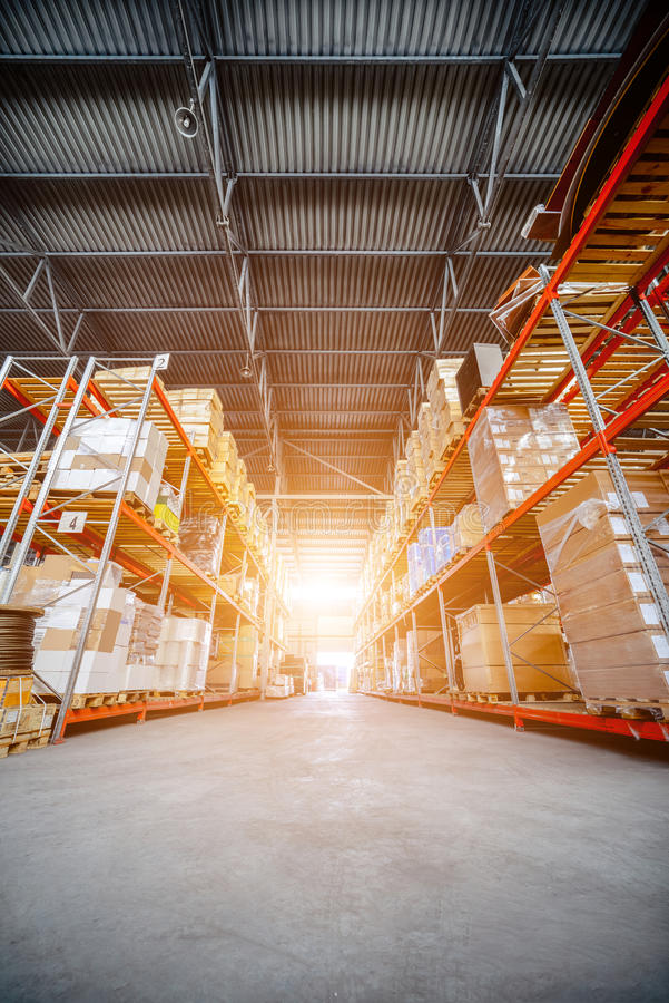 Large hangar warehouse industrial and logistics companies. Large hangar warehouse of logistics companies. Warehousing on the floor and called the high shelves stock images