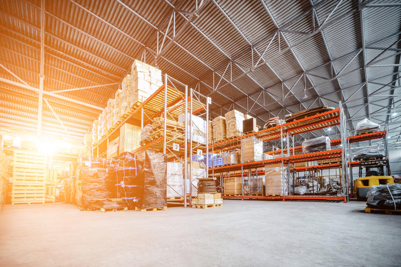 Large hangar warehouse industrial and logistics companies. Warehousing on the floor and called the high shelves. Toning the image royalty free stock image