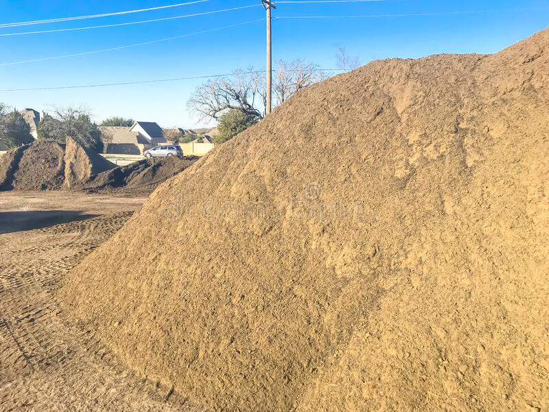 Large heap of organic topsoil pile at wholesale compost plant near Dallas, Texas. Organic topsoil pile at wholesale compost plant near Dallas, Texas, America stock images
