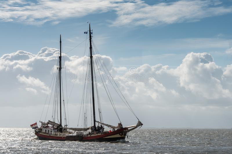 Large historic sailing ships on the Wadden Sea, group travel, seal tour stock photography