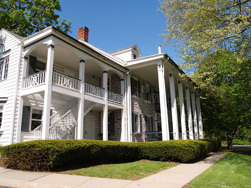 Large home with front porch with columns stock photo for House plans with columns and porches