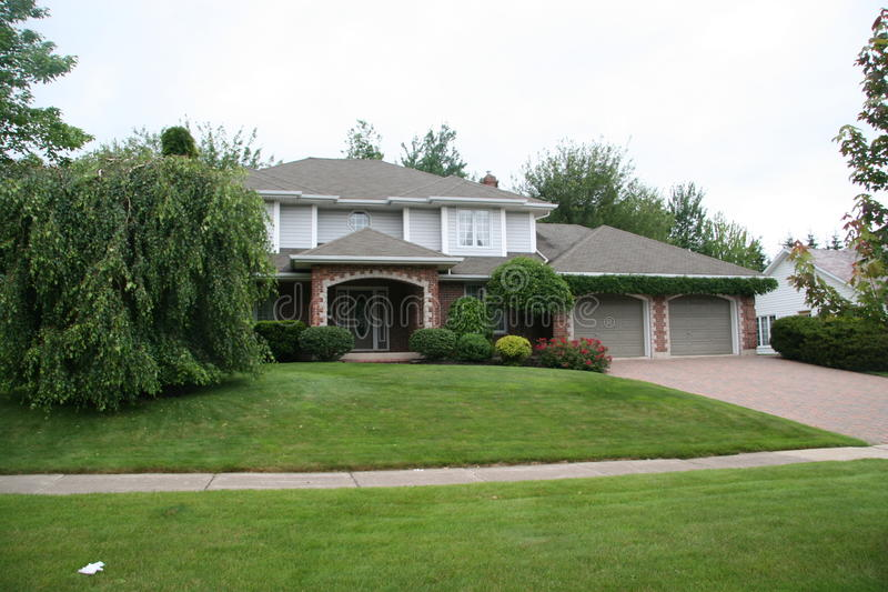 Large home in suburbia stock photos