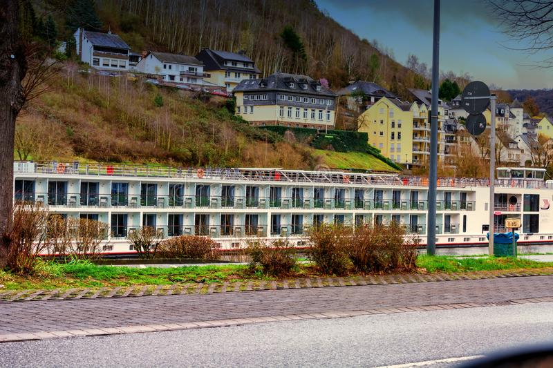 Large hotel ship for a river cruise along the Mosel. COCHEM, Germany - March 27, 2016: River cruises with cruise ship Viking Modi on the Moselle near Cochem stock photos